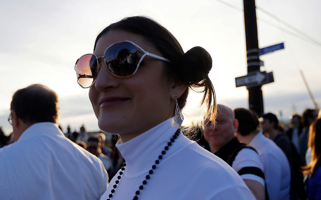 ". Michell Niemeyer, dressed as Princess Leia, silhouetted as members of the Krewe of Chewbacchus, a Mardi Gras Krewe, hold a parade, in honor of actress Carrie Fisher, who played her role in the ""Star Wars\"" movie series, in New Orleans, Friday, Dec. 30, 2016. Fisher died on Dec. 27, 2016, at the age of 60. (AP Photo/Gerald Herbert)"
