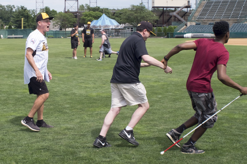 07/02/19  Wesley Bunnell | Staff  The New Britain Bees welcomed group home members to New Britain Stadium as part of the Beautiful Lives Project on Tuesday July 2, 2019.Bees players and coaches played wiffle ball games on the outfield grass with the participants. Bryce Weiler, 2nd from L, who's is legally blind. receives assistance running the bases after a base hit as hitting coach Chuck Stewart, L, looks on.