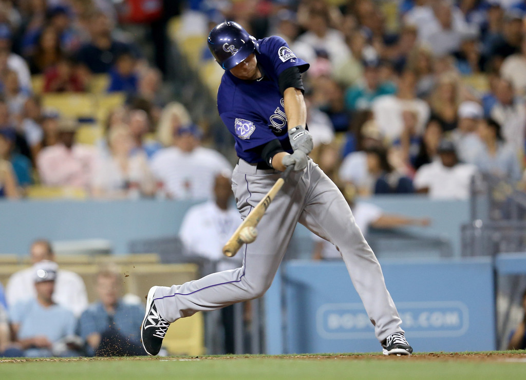 . LOS ANGELES, CA - JULY 12:  DJ LeMahieu #9 of the Colorado Rockies hits an RBI single in the fifth inning against the Los Angeles Dodgers at Dodger Stadium on July 12, 2013 in Los Angeles, California.  (Photo by Stephen Dunn/Getty Images)