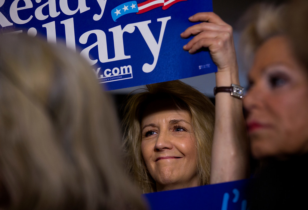 """. Supporters listen during a speech at the \""""Last Hillary Clinton Rally\"""" as part of the Ready for Hillary campaign in New York, Saturday, April 11, 2015. Dozens of supporters, elected officials and Democratic leaders gathered at the fundraiser the day before Hillary Clinton is expected to officially announce her presidential campaign. (AP Photo/Craig Ruttle)"""