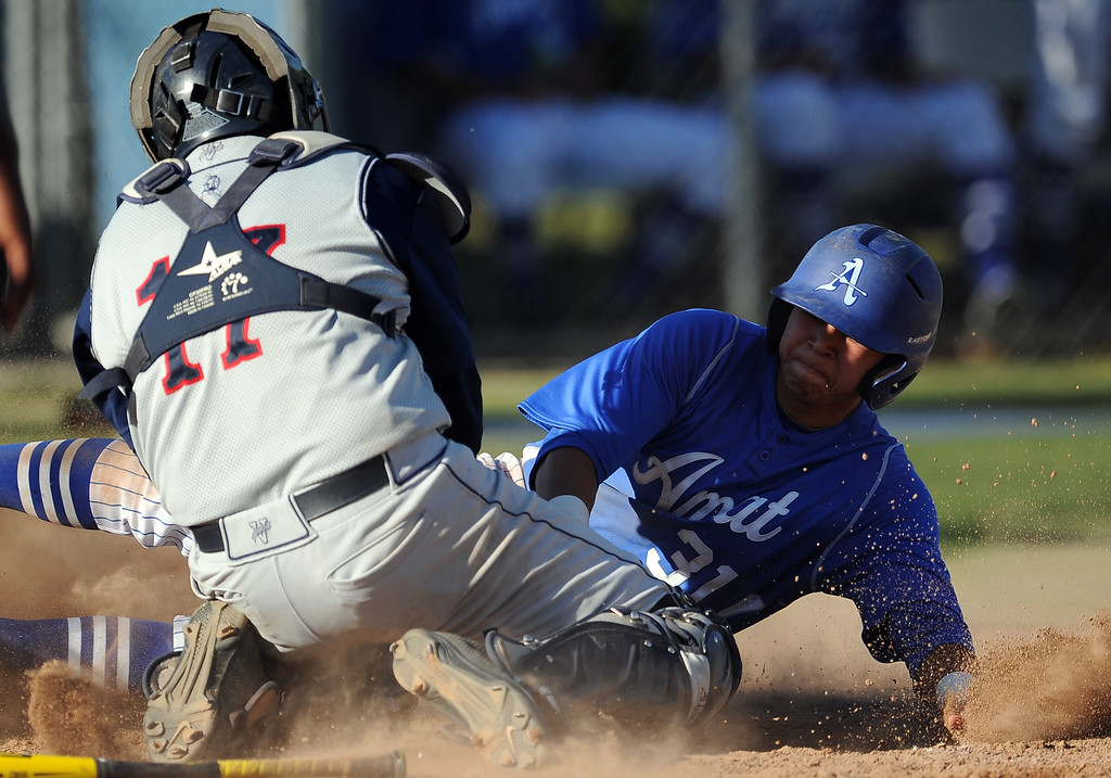 . St. Paul catcher Joe Argumedo tags out Bishop Amat\'s Evan Claproth (31) at home plate in the sixth inning of a prep baseball game at Bishop Amat High School on Friday, April 19, 2012 in La Puente, Calif. Bishop Amat won 3-2.    (Keith Birmingham/Pasadena Star-News)