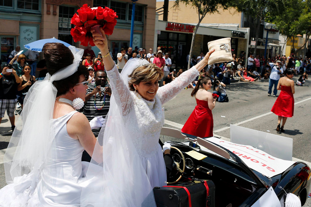 . Civil rights lawyer Gloria Allred wears a wedding dress while riding in support of Marriage Equality during the 43rd annual L.A. LGBT Pride Parade in West Hollywood June 9, 2013. The parade celebrates the lesbian, gay, bisexual and transgender communities in Los Angeles. REUTERS/Patrick T. Fallon