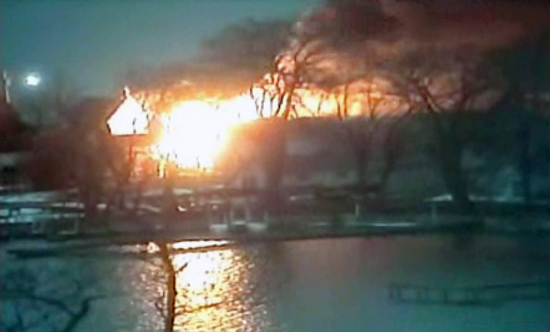 . This image taken from video provided by WHAM13-TV, shows a wide view of homes on fire in an area where a gunman ambushed four volunteer firefighters responding to an intense pre-dawn house fire early Monday, Dec. 24, 2012, in Webster, N.Y., killing two before ending up dead himself, authorities said. Police used an armored vehicle to evacuate more than 30 nearby residents. (AP Photo/WHAM13-TV via AP video)