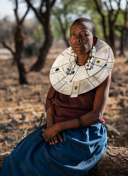 Portrait of a Masai woman wearing the traditional big necklace.  Tanzania, 2019