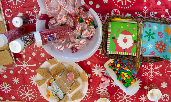 12/27/19 Wesley Bunnell | StaffrrGingerbread house making took place on Friday afternoon at the New Britain Youth Museum in New Britain. A table with samplings of candy to use for the houses is shown.