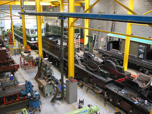 The restoration workshops (with City of Thoro in pieces), National Railway Museum, York.