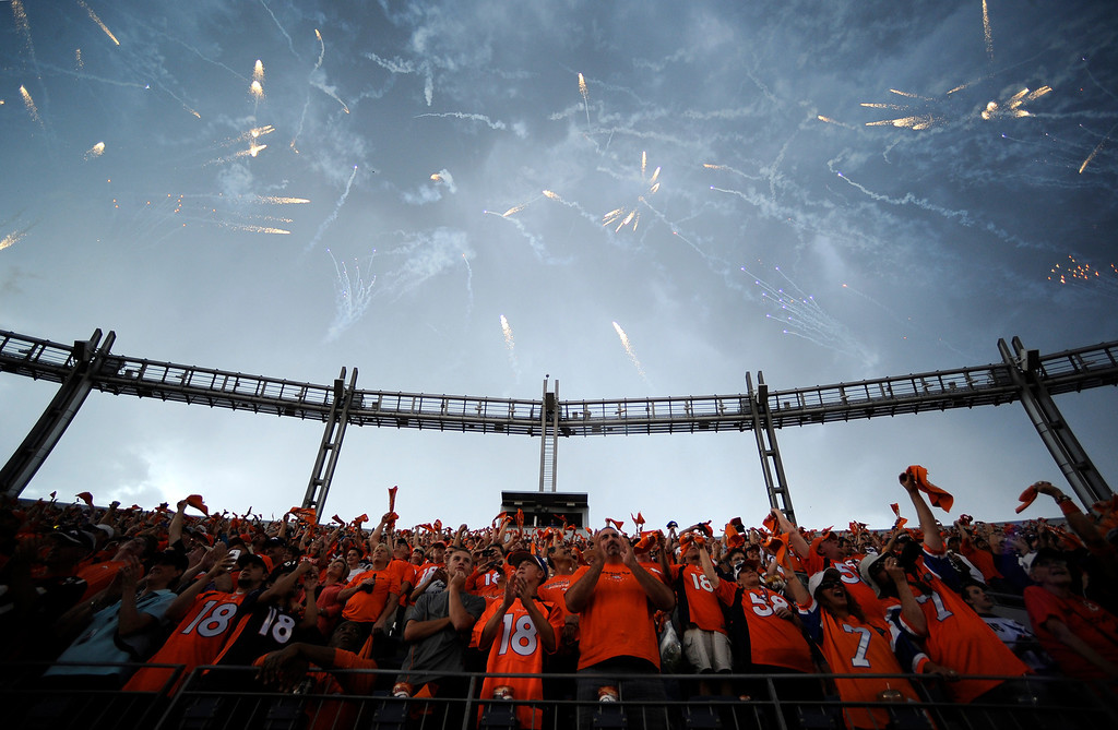 . DENVER, CO - SEPTEMBER 05: Broncos fans cheer as the Broncos take the field before the game. The Denver Broncos took on the Baltimore Ravens in the first game of the 2013 season at Sports Authority Field at Mile High in Denver on September 5, 2013. (Photo by AAron Ontiveroz/The Denver Post)