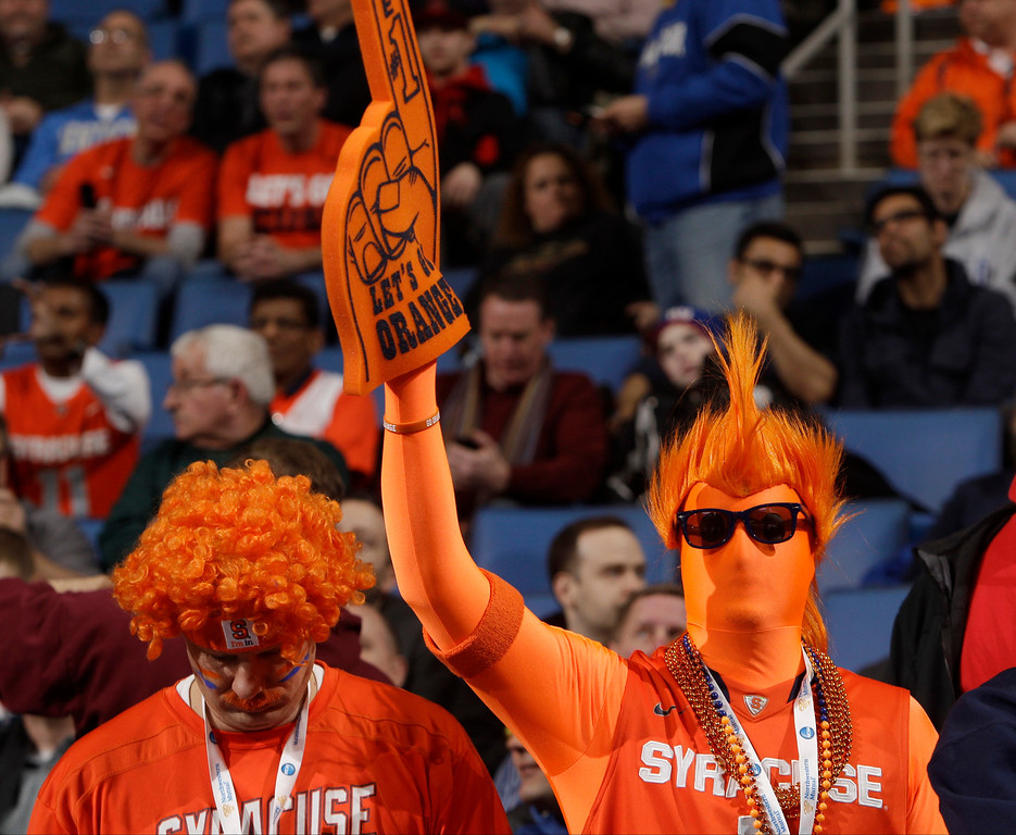 . A Syracuse fan cheers before the team\'s third-round game against Dayton in the NCAA men\'s college basketball tournament in Buffalo, N.Y., Saturday, March 22, 2014. (AP Photo/Bill Wippert)