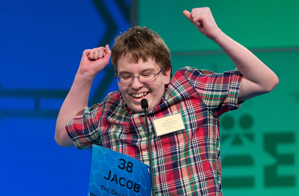 ". Eighth grade home-schooled student Jacob Williamson, 15, of Cape Coral, Fla., reacts after correctly spelling his word ""harlequinade\"", during the semifinals of the Scripps National Spelling Bee, Thursday, May 29, 2014, at National Harbor in Oxon Hill, Md. Williamson spelled his word correct.  (AP Photo/Manuel Balce Ceneta)"