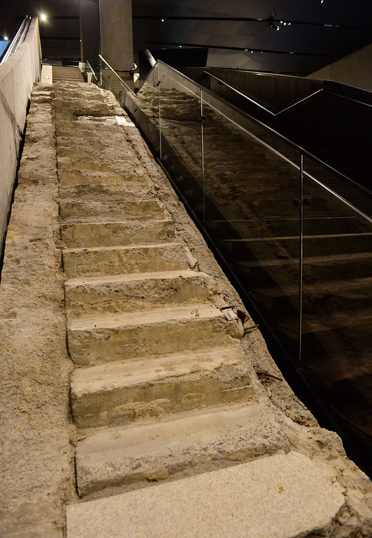 """. The \""""Survivor Stairs\"""", remnants of a Vesey Street staircase where many people who worked at the World Trade Center towers during the September 11, 2001 attack escaped to the street, seen during a press preview of the National September 11 Memorial Museum at the World Trade Center site May 14, 2014 in New York. AFP PHOTO/Stan HONDA/AFP/Getty Images"""