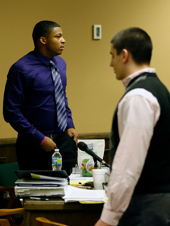 . Ma\'lik Richmond, 16, left, and co-defendant Trent Mays, 17,  right, walks around in the court room during a break on the fourth day of the juvenile trial for he and co-defendant  on rape charges in juvenile court on Saturday, March 16, 2013 in Steubenville, Ohio. Mays and Richmond are accused of raping a 16-year-old West Virginia girl in August, 2012. Judge Thomas Lipps said he would render a decision on Sunday morning, March 17. (AP Photo/Keith Srakocic, Pool)