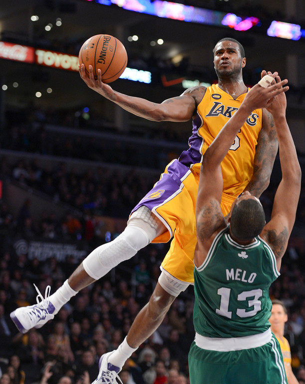 . Lakers Earl Clark goes up over Celtics\' Fab Melo for two points during second half action at Staples Wednesday. Lakers defeated the Celtics 113-99.  Photo by David Crane/Staff Photographer
