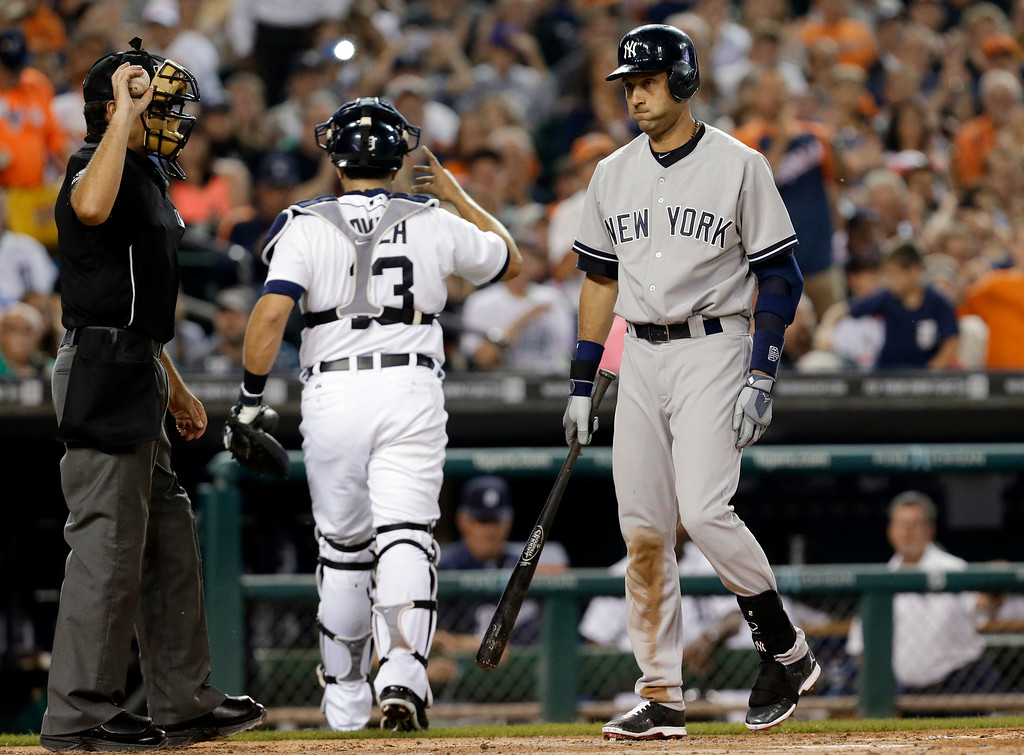 . New York Yankees\' Derek Jeter heads back to the dugout after striking out looking against the Detroit Tigers in the second inning of a baseball game in Detroit Tuesday, Aug. 26, 2014. (AP Photo/Paul Sancya)