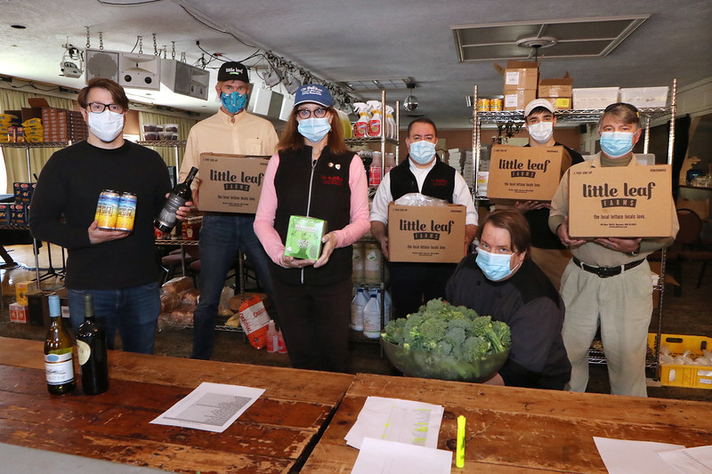 From left (indoors): Bull Run manager Arthur Guercio, Little Leaf Lettuce founder and CEO Paul Sellew, Bull Run restaurant owner Alison Tocci, general manager Bryan Sawyer, executive chef Stephen Barck, and Bull Run employees Luke Junek and Barry Rich.  (SUN/Julia Malakie)