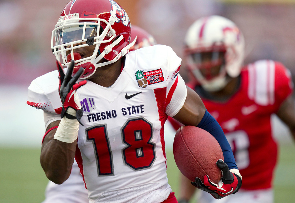 . Fresno State defensive back Sean Alston (18) returns an interception of an SMU pass in the third quarter of the Hawaii Bowl, an NCAA college football game Monday, Dec. 24, 2012, in Honolulu. (AP Photo/Eugene Tanner)