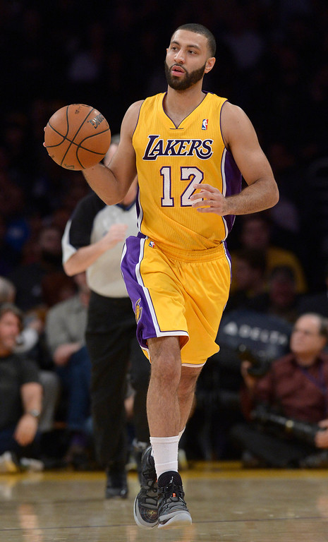 . <b>Kendall Marshall</b>, point guard, averaged 7.8 points and 8.8 assists through 29 minutes in 53 games <br /><br /> <b> Outlook</b>: The Lakers will likely exercise their team option on Marshall despite his weaknesses. It helps Marshall�s non-guaranteed contract will cost a $915,242, far from the NBA�s average salary of $5.5 million.   (Photo by John McCoy / Los Angeles Daily News)