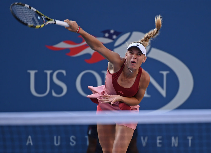 . Caroline Wozniacki of Denmark serves to  Serena Williams of the US during their US Open 2014 women\'s singles finals match at the USTA Billie Jean King National Center September 7, 2014  in New York. STAN HONDA/AFP/Getty Images