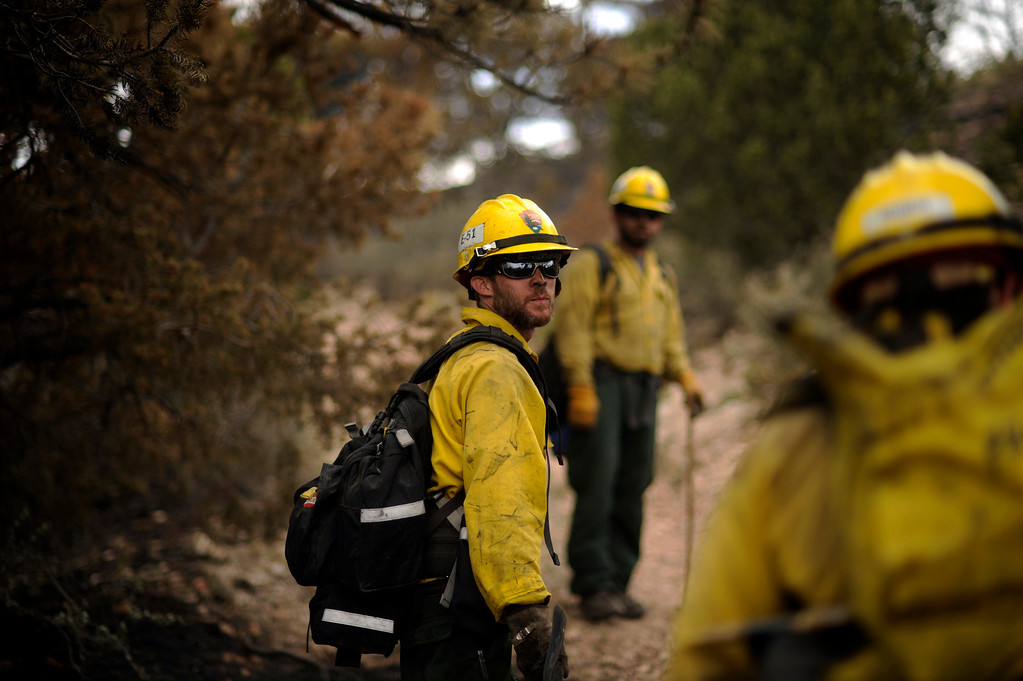 . Brian Kioclease, left, and firefighters from Kings Canyon, CA check hot spots near Cedar Heights Road from the Waldo Canyon Fire west of Colorado Springs, Colo., Friday, June 29, 2012. Hyoung Chang, The Denver Post
