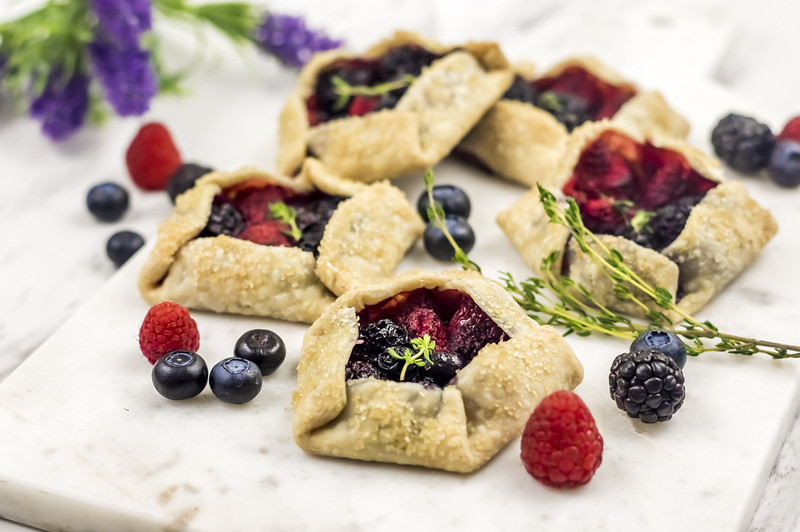 This Mixed Berry Galette Minis Recipe using three types of summer berries for a perfect end of summer (or wanting it to feel like summer year round) treat!