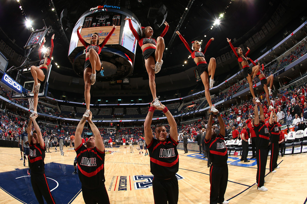 . Cheerleaders of the Louisville Cardinals perform during a timeout against the Connecticut Huskies during the Championship of the American Athletic Conference Tournament at FedExForum on March 15, 2014 in Memphis, Tennessee. Louisville defeated Connecticut 71-61. (Photo by Joe Murphy/Getty Images)