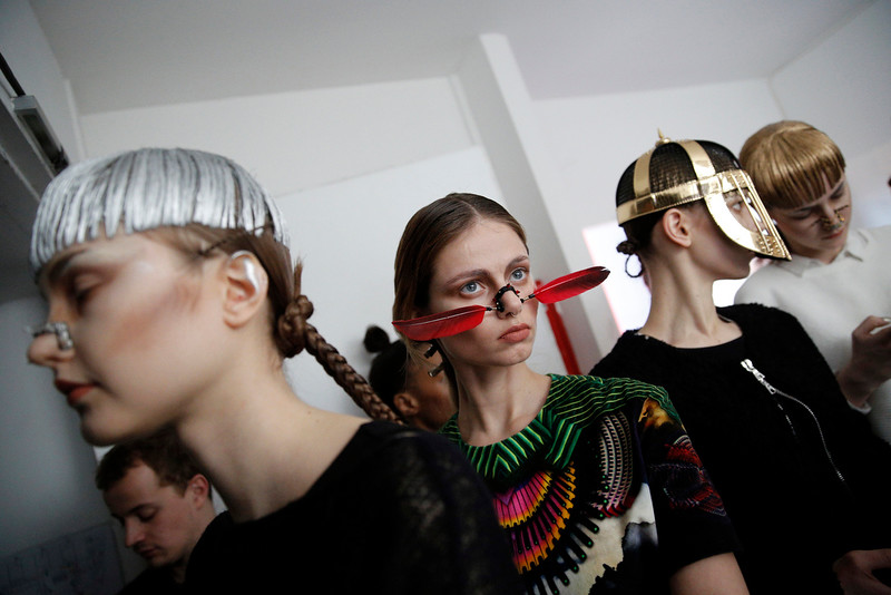 . Models wait backstage before Indian fashion designer Manish Arora\'s fall-winter 2015-2016 ready-to-wear fashion collection, as part of the Paris Fahion Week, presented in Paris, France, Thursday, March 5, 2015. (AP Photo/Christophe Ena)