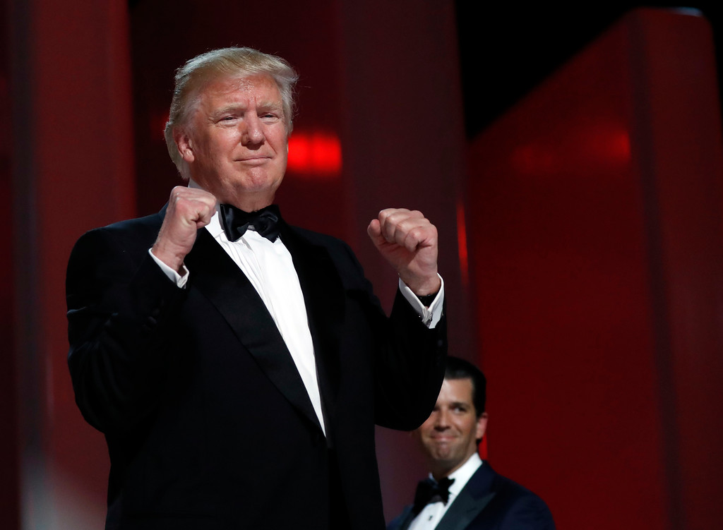 . President Donald Trump acknowledges the crowd at the Liberty Ball, Friday, Jan. 20, 2017, in Washington. (AP Photo/Alex Brandon)