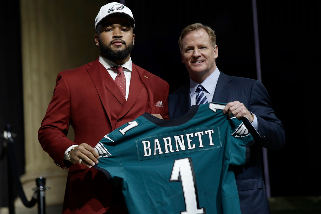 . Tennessee\'s Derek Barnett, left, poses with NFL commissioner Roger Goodell after being selected by the Philadelphia Eagles during the first round of the 2017 NFL football draft, Thursday, April 27, 2017, in Philadelphia. (AP Photo/Matt Rourke)