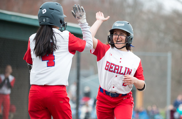 04/12/19 Wesley Bunnell | Staff Berlin softball defeated Platt Tech in an afternoon home game at Sage Park on Friday. Jenna Zup (2) high fives Casey Uryga (4) after sliding safely into home.