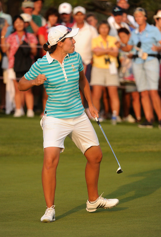 . PARKER, CO. - AUGUST 17: Spanish golfer Carlota Ciganda pumped her fist after sinking a putt on the 18th green at the Solheim Cup Saturday. Ciganda and teammate Azaha Munoz took a point away from Americans Gerina Piller and Angela Stanford.  It was the American Team versus the Europeans as play continued at the Colorado Golf Club Saturday afternoon, August 17, 2013. Photo By Karl Gehring/The Denver Post