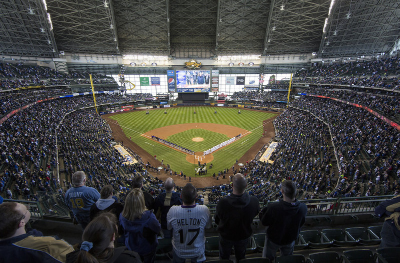 . The Colorado Rockies and Milwaukee Brewers line the base lines during the National Anthem on opening day at Miller Park on April 1, 2013 in Milwaukee, Wisconsin.  (Photo by Tom Lynn/Getty Images)