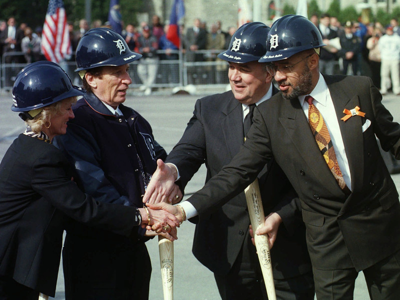 . Detroit Mayor Dennis Archer, right, and Gov. John Engler shake hands with Marian and Mike Ilitch during groundbreaking ceremonies at the site of the new Tigers stadium in Detroit, Wednesday, Oct. 29, 1997. Archer is enjoying wide support in the community. He also has enjoyed favorable coverage in the news media and has strong relations with business leaders. Archer is expected to win easily in his bid for a second term. (AP Photo/Carlos Osorio)
