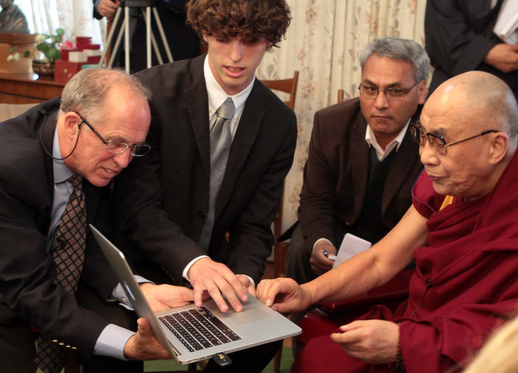 . Mount Madonna School teacher Ward Maillard and student Jake Getz show the Dalai Lama an online curriculum on Wednesday, April 3, 2013, that Mount Madonna students have created based on the teachings of the Tibetan Buddhist leader.