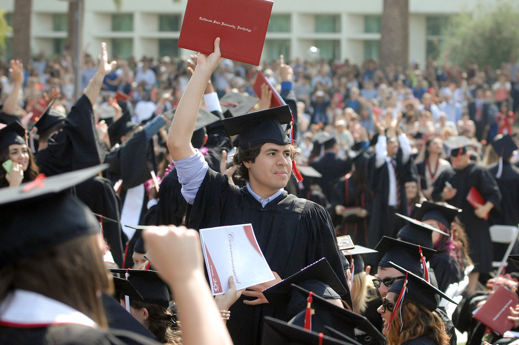 . Graduates acknowledge their parents at the CSUN commencement ceremony, Tuesday, May 21, 2013. (Michael Owen Baker/L.A. Daily News)