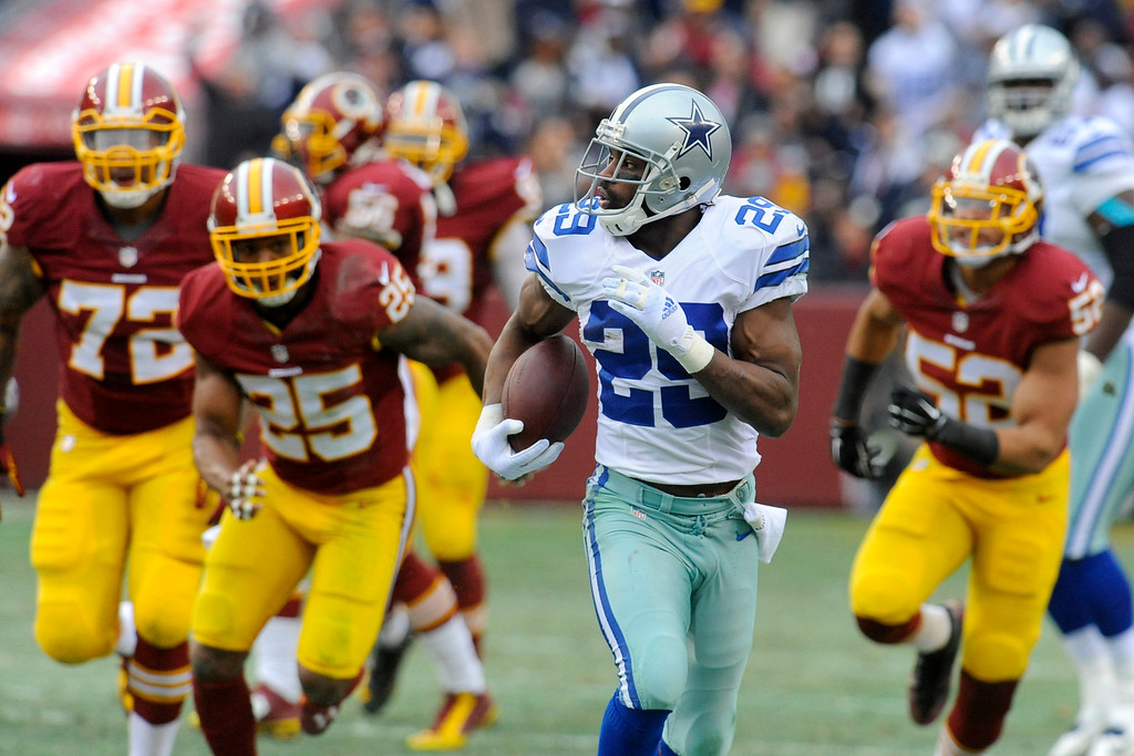 . Dallas Cowboys running back DeMarco Murray (29) carries the ball during the first half of an NFL football game against the Washington Redskins in Landover, Md., Sunday, Dec. 28, 2014. Murray set the franchise single-season rushing record for the Cowboys on the play. (AP Photo/Richard Lipski)