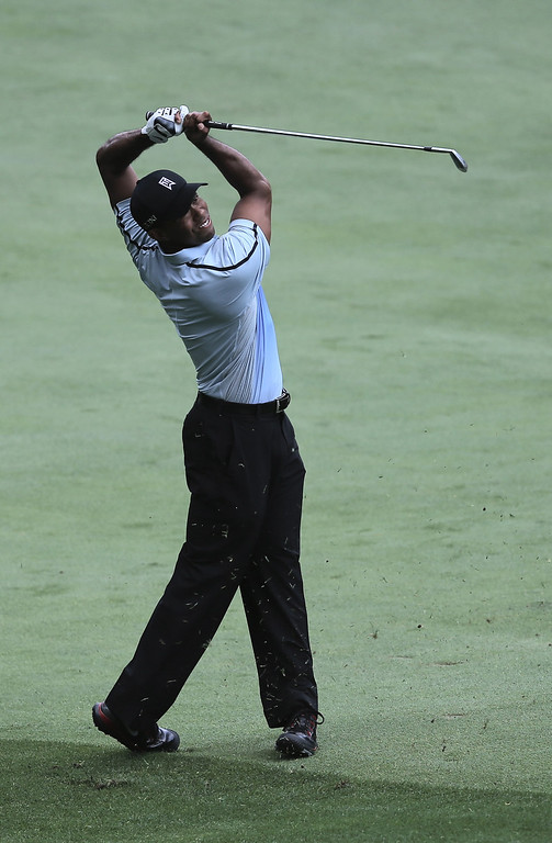 . ROCHESTER, NY - AUGUST 08:  Tiger Woods of the United States hits a shot on the ninth hole during the first round of the 95th PGA Championship on August 8, 2013 in Rochester, New York.  (Photo by Rob Carr/Getty Images)