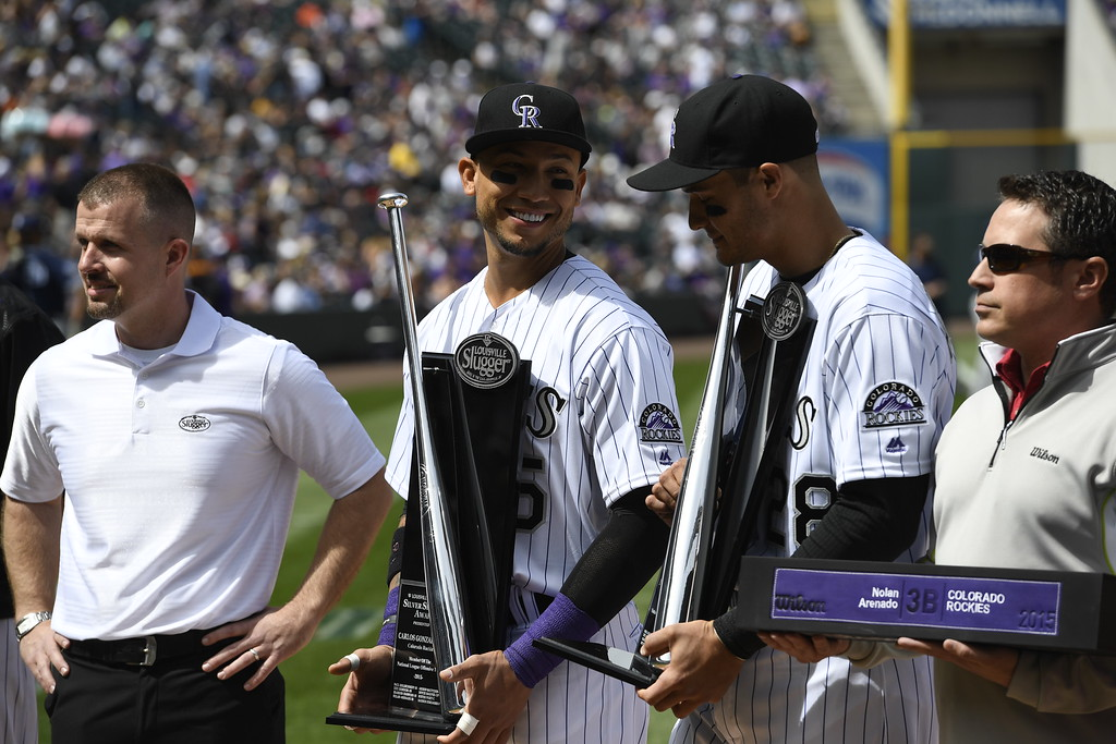 . Carlos Gonzalez (5) and Nolan Arenado (28) of the Colorado Rockies receive awards before the game. The Colorado Rockies played the San Diego Padres Friday, April 8, 2016 on opening day at Coors Field in Denver, Colorado. (Photo By Andy Cross/The Denver Post)
