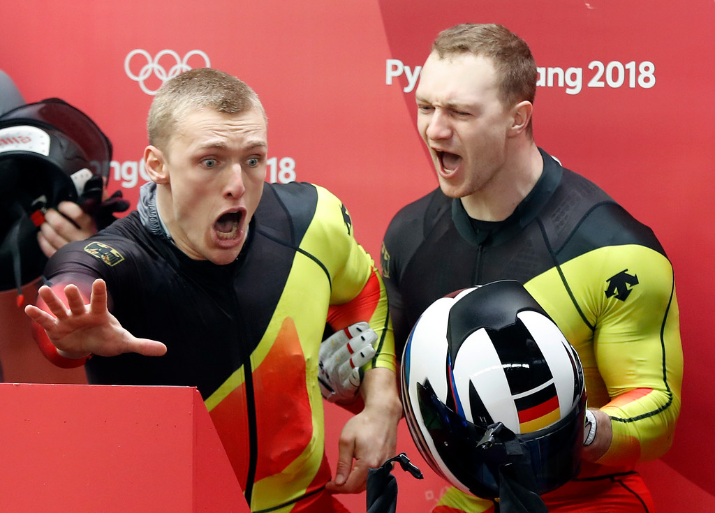 . Driver Francesco Friedrich, right, and Thorsten Margis of Germany celebrate after they tied for the gold medal during the two-man bobsled final at the 2018 Winter Olympics in Pyeongchang, South Korea, Monday, Feb. 19, 2018. (AP Photo/Andy Wong)