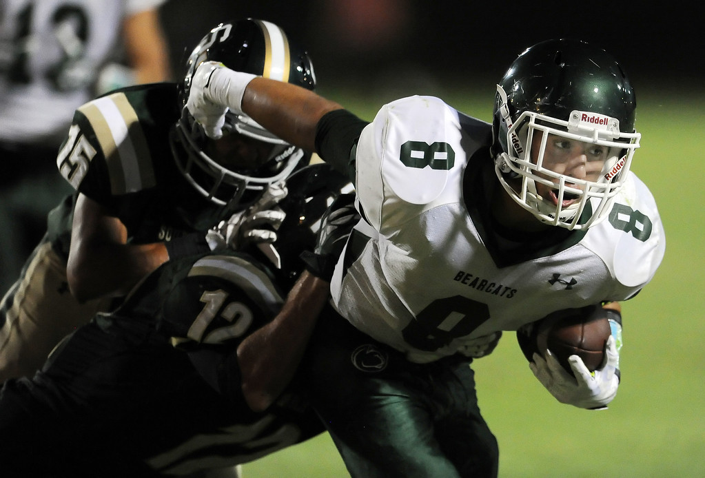 . Bonita\'s Christian Ramos runs for a first down past South Hills\' Carlos Delgado (15) and Adam Goss (12) in the first half of a prep football game at Covina District Field in Covina, Calif. on Friday, Sept. 6, 2013.   (Photo by Keith Birmingham/Pasadena Star-News)