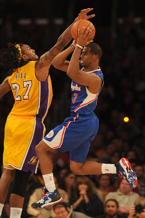 . Lakers#27 Jordan Hill confronts Clippers#3 Chris Paul in the 4th quarter. The Los Angeles Lakers defeated the Clippers 116 to 103 in the opening game of the season at Staples Center. Los Angeles, CA. 10/29/2013. photo by (John McCoy/Los Angeles Daily News)