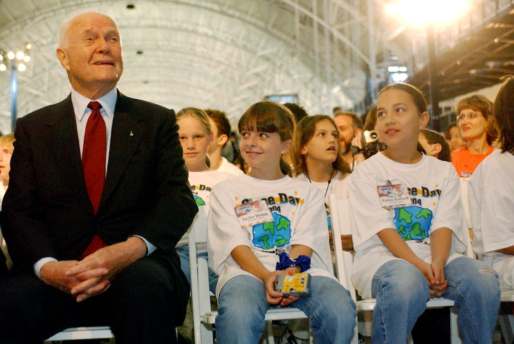 . Former astronaut and senator John Glenn, left, sits with Walkersville (Md.) Elementary School students Taylor Huddak, 9 and Emma Kidwell, 10, Thursday, May 6, 2004 at Space Day presented at the National Air and Space Museum-Steven F. Udvar-Hazy Center in Chantilly, Va. The Space Day celebration was to introduce a new class of astronauts, including three educators.  (AP Photo/Linda Spillers)
