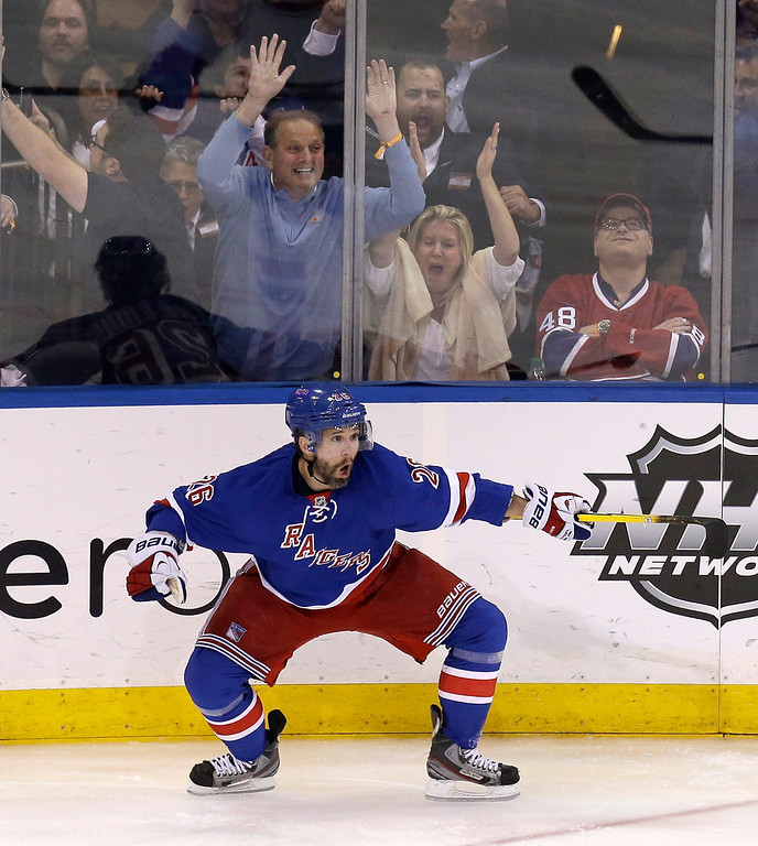 . New York Rangers\' Martin St. Louis celebrates his game-winning goal during overtime in Game 4 of the NHL hockey Stanley Cup playoffs Eastern Conference finals against the Montreal Canadiens, Sunday, May 25, 2014, in New York. The Rangers defeated the Canadiens in overtime 3-2. (AP Photo/Seth Wenig)