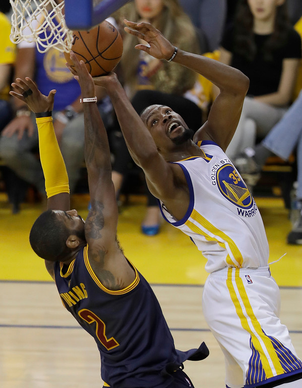 . Golden State Warriors forward Kevin Durant, right, shoots against Cleveland Cavaliers guard Kyrie Irving during the first half of Game 1 of basketball\'s NBA Finals in Oakland, Calif., Thursday, June 1, 2017. (AP Photo/Marcio Jose Sanchez)