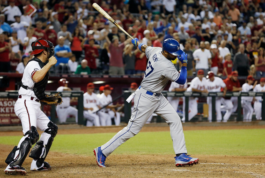 . Los Angeles Dodgers\' Matt Kemp (27) strikes out to end the game as Arizona Diamondbacks\' Wil Nieves pumps his fist in the ninth inning of a baseball game on Monday, Sept. 16, 2013, in Phoenix.  The Diamondbacks defeated the Dodgers 2-1.  (AP Photo/Ross D. Franklin)