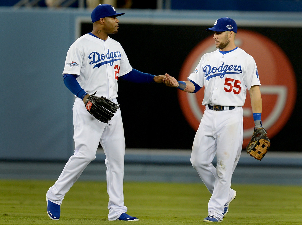 . Los Angeles Dodgers\' Carl Crawford and Skip Schumaker celebrate defeating the Braves at the end of game 3 of the NLDS at Dodger Stadium Sunday, October 6, 2013. (Photo by Hans Gutknecht/Los Angeles Daily News)