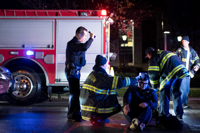 A student who was struck by a car around 5:40 p.m. near Sheridan Road and Hinman Avenue in Evanston, Ill. on Friday, November 17, 2017. The vehicle, a Lexus automobile, is visible on the left. | Colin Boyle/The Daily Northwestern