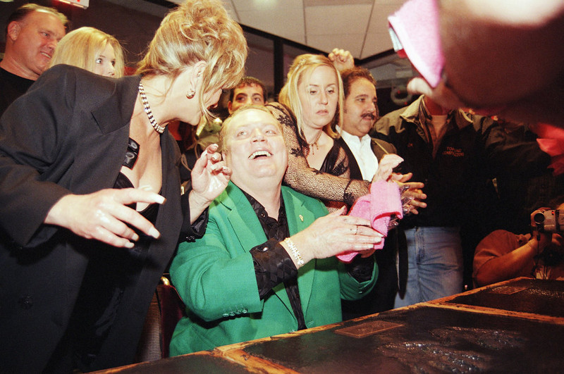 . Hustler magazine founder Larry Flynt smiles at porn actress Marilyn Chambers after placing his hands in cement for the ?Hustler Porn Walk of Fame, during opening festivities at Hustler Hollywood, described as a erotic department store, Thursday, Dec. 3, 1998 in West Hollywood, California. Also shown is Flynt?s daughter, Theresa, second from right and porn actor, Ron Jeremy, right. (AP Photo/Katie Callan)