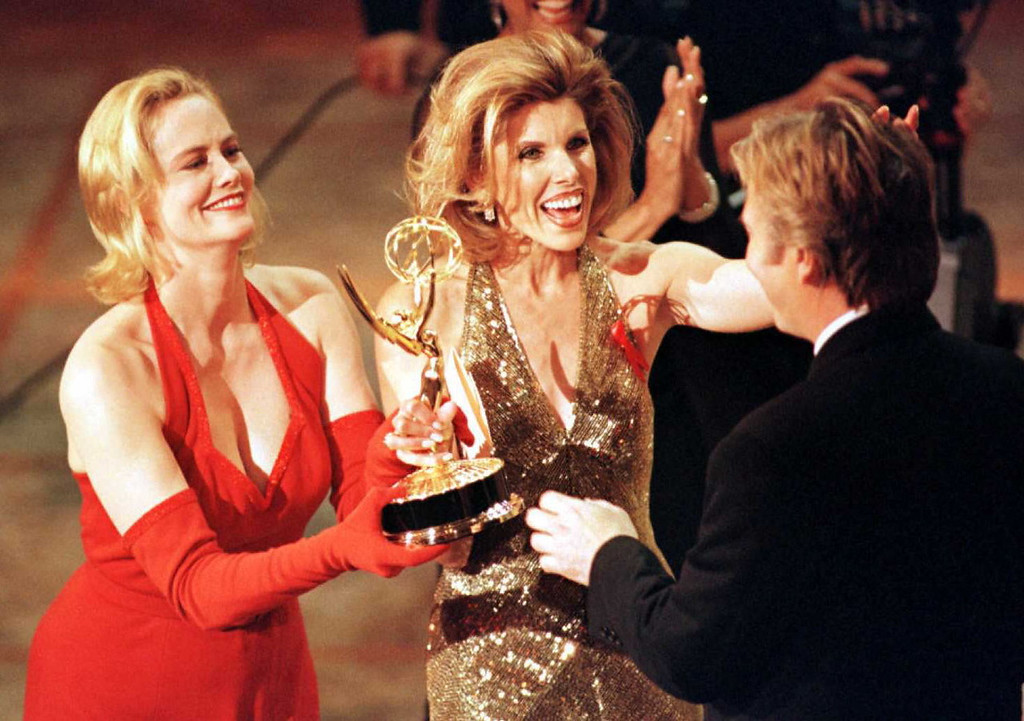 """. Actresses Cybill Shepherd (L) and Christine Baranski (C) present an Emmy to Alan Rickman (R) for outstanding lead actor in a mini-series or special for his lead role in the HBO production of \""""Rasputin\"""" during the 48th Annual Emmy Awards 08 September in Pasadena, California. (Vince Bucci/AFP/Getty Images)"""