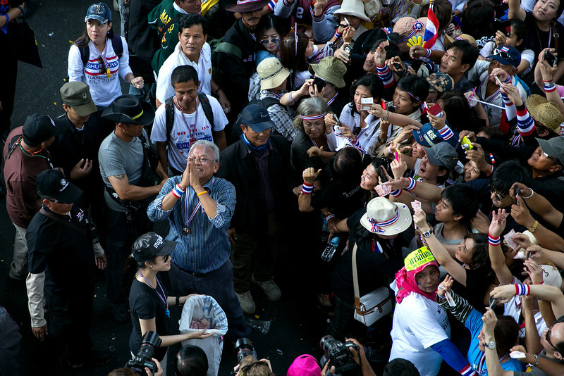 """. People\'s Democratic Reform Committee (PDRC) leader Suthep Thaugsuban (center) parades in downtown Bangkok on the first day of the \""""Bangkok Shutdown\"""" on January 13, 2014 in Bangkok, Thailand. Anti-government protesters launch \""""Bangkok Shutdown\"""", blocking major intersections in the heart of the capital, as part of their bid to oust the government of Prime Minister Yingluck Shinawatra ahead of elections scheduled to take place on February 2. (Photo by Paula Bronstein/Getty Images)"""