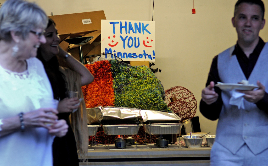 ". A homemade sign that says ""Thank You Minnesota\"" was hung above the buffet line at the home of Bradley Weber and Ryan Pfeifle in Eden Prairie. (Pioneer Press: Sherri LaRose-Chiglo)"