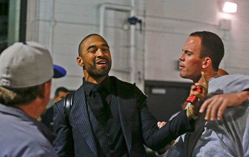 . Los Angeles Dodgers\' Matt Kemp, left, and San Diego Padres\' Clayton Richard have their hands on each other after Richard stopped Kemp when he confronted the Padres\' Carlos Quentin in the tunnel walk-way exiting Petco Park following the  baseball game between the Los Angeles Dodgers and San Diego Padres in which a brawl occurred when Quentin was hit by a pitch from the Dodgers\' Zack Greinke in San Diego, Thursday, April 11, 2013. Greinke suffered a broken left collarbone in the brawl.   (AP Photo/Lenny Ignelzi)